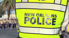Back of New Orleans Police Officer during Endymion parade Stock Footage