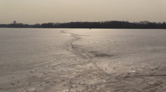 Crack In Icy frozen Surface. Spring floating of ice. Melting Stock Footage