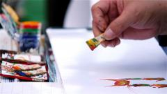 Stock Video Footage of chinese street artist make draws; painter, color, colour, writing,