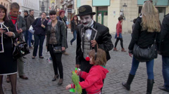 Circus man on street show, birds, small animals, Charlie Chaplin character Stock Footage