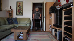 80 years old woman with walker at home, elderly woman, disabled person walking Stock Footage