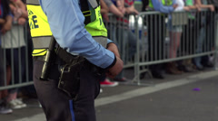 Stock Video Footage of Police officer with hand on waist belt