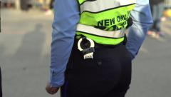 Two police officers standing next to one another Stock Footage