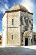 san giovanni baptistery, volterra, italy - stock photo