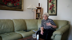 80 years old woman taking pills, heart attack, chest pain, sick elderly female - stock footage