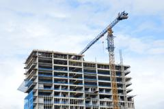 crane on a building in construction - stock photo