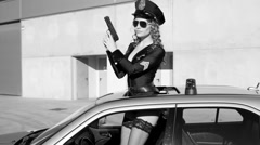 Sexy police woman dancer Stock Footage