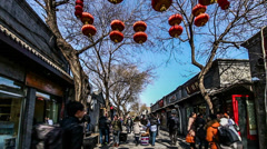 There are lots of fashion store in famous Nanluogu alley of Beijing Stock Footage