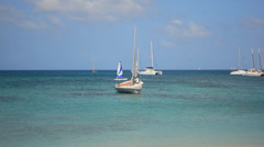 Sailboat and windsurfer in paradise Stock Footage