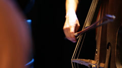 Close up of man playing the cello Stock Footage