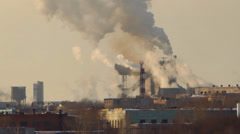Factory smoke emissions over the city, winter Stock Footage