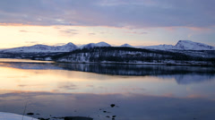 Scandinavian panning view Norwegian winter Fjord snow fading daylight - stock footage