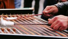 Street artist plays cymbalum; Rome, Navona square, gypsy, gipsy, musician Stock Footage