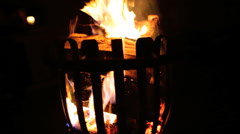 Flames flickering outdoor wood burning fire night time Stock Footage