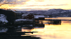 Winter Fjord Tromso coastal region sunset skyline snow built structure Stock Footage