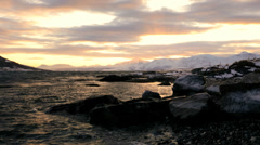 Winter snow Norwegian Fjord shoreline fading sunlight scenic seascape Stock Footage