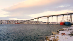 Tromso Bridge cantilever road bridge nautical vessels fading sunlight Tromso Stock Footage