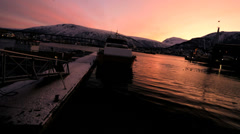 Fading sunlight winter colour sunset Fjord Tromso Harbour Artic Circle Norway - stock footage