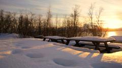 Tromso Fjord Norway winter daylight frozen landscape fading sunlight panning - stock footage