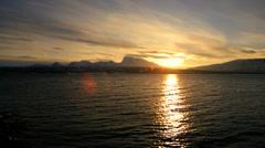 Winter snow Norwegian Fjord nr Tromso shoreline fading sunlight scenic - stock footage
