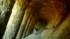 Amazing Guell Park in Barcelona,diagonal colonnaded pathway, Spain Stock Footage