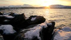 Winter snow Norwegian Fjord nr Tromso fading sunlight scenic seascape Stock Footage