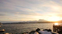 Norwegian Fjord nr Tromso shoreline built structure fading sunlight panning Stock Footage