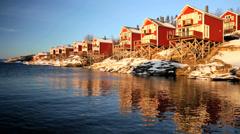 Norwegian Fjord nr Tromso shoreline houses fading sunlight seascape - stock footage