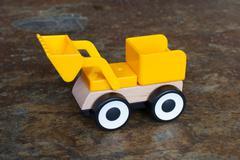 Simple wheel dozer toy Stock Photos