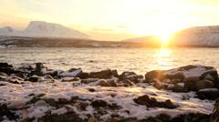Tromso Fjord shoreline Norway winter daylight frozen landscape fading sunlight - stock footage