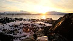 Tromso Fjord Norway winter daylight frozen landscape fading sunlight - stock footage