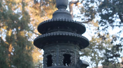 Closeup of a vase in the forbidden city with group of people Stock Footage