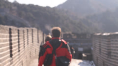 A closeup of some people walking away from the camera and in the background Stock Footage