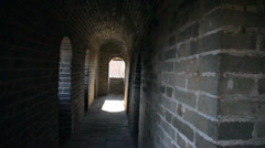 A view of a person on the great wall from inside a window in the watchtower Stock Footage