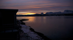 Time lapse Fjord dawn breaking winter scene tourist resort Norway - stock footage