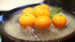 A mandarin orange desert in a peking duck restaurant Stock Footage