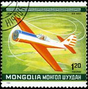 Mongolia - circa 1980: a stamp printed in mongolia shows the jak-50 plane, fr Stock Photos