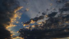 Clouds are illuminated by the setting sun Stock Footage