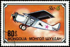 mongolia- circa 1976: a stamp printed in mongolia shows airplane jak-6, serie - stock photo