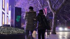 People walking on a colorful evening on huaihai during christmas Stock Footage
