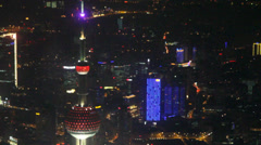 Pearl tower tilt shot in evening seen from the Shanghai Financial Center Stock Footage