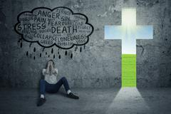 depressed man with sign of cross - stock illustration