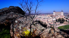 Medieval city of Toledo and Alcazar fortification, view from rocks Stock Footage