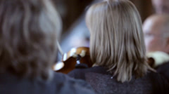 Pan through an orchestral string section Stock Footage