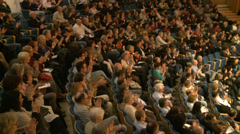 Semi focus on audience clapping hands - stock footage