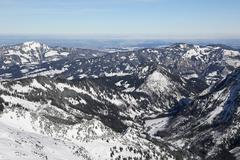 Aerial view of snow covered mountains in winter Stock Photos