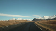 Stock Video Footage of Driving toward scenic snowy mountains in Eastern Iceland