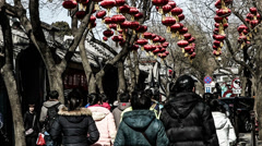 The famous Nanluogu alley is full of visitors during holiday in Beijing Stock Footage