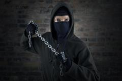 Dangerous murderer with chain Stock Photos