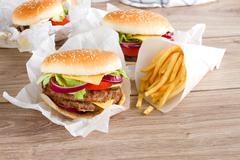 fresh hamburgers with french fries - stock photo
